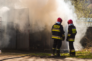 Fire garages, action fire extinguishing by the service: fire brigade and Police