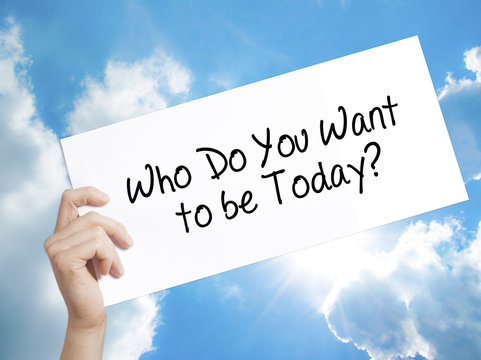 Who Do You Want to be Today? Sign on white paper. Man Hand Holding Paper with text. Isolated on sky background.