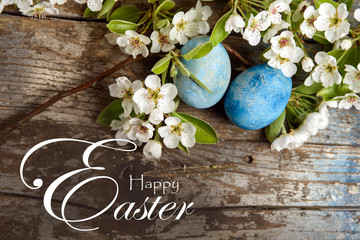 Happy Easter Background With Blue Painted Eggs White Flowers On Wood