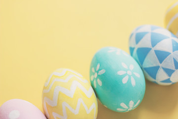 Pastel and colorful cute easter eggs with on colorful background with copy space