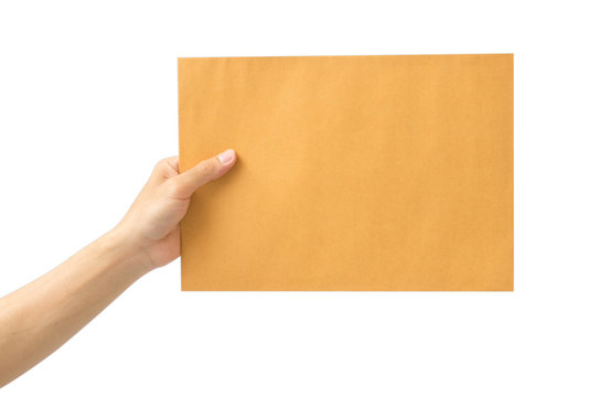hand holding brown envelope on white background