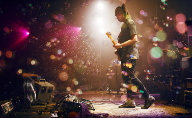 Guitarist performing on stage. Concert.