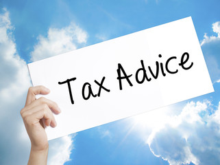Tax Advice Sign on white paper. Man Hand Holding Paper with text. Isolated on sky background