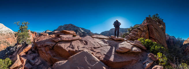 Female Backpacker Stands Toward the Sun Along trail to Angels Landing Wall mural