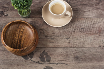 Coffee espresso, bonsai tree and bamboo bowls on a wooden table background. Dark wood. Empty place, copy space Morning in office. Top view