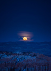 Full Moon Rising Over Hoodoos with Copy Space