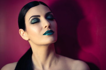 beautiful woman with turquoise makeup
