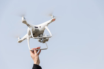 Hand catch of drones with female arms