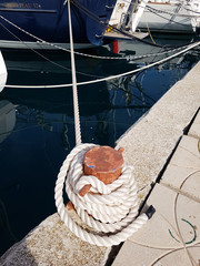 Close-up of mooring lines and ropes on the dock