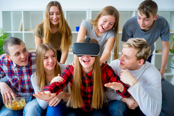 Group of friends playing with VR