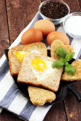 fried eggs and toast with basil pepper and salt