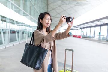 Woman taking photo in Hong Kong international airport