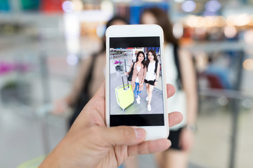 Taking photo with cellphone in airport
