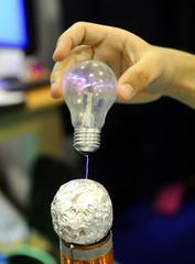 Light bulb sparks in hand