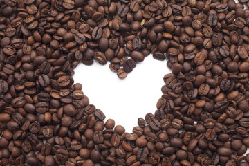 Heart shape made of Coffee beans over seeds background