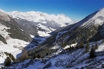 Picturesque view from the top of the mountain on the Hintertux glacier, the Zillertal Valley, Austria. Clouds lying in the mountains.
