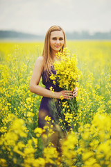 beautiful blonde girl on summer meadow