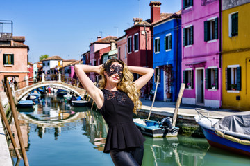 Girl wearing a black mask in Burano Island, Italy