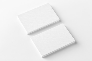 Mockup of two horizontal business cards stacks at white textured background. Angle view Wall mural