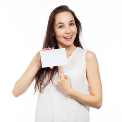 Cheerful woman pointing at a blank business card
