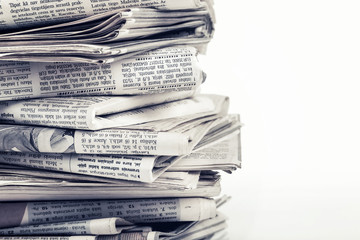 closeup stack of the newspapers