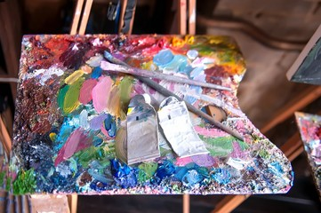 Palette with artists brushes and oil paints