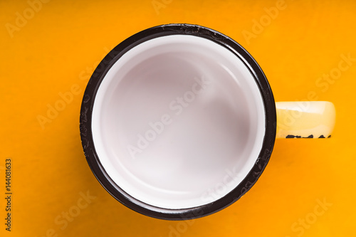 Empty Cup Top : Quot empty enameled cup on the yellow background top view