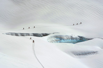 Mountaineers aroud crevasses on Monte Rosa, Aosta Valley, Itlay, Europe