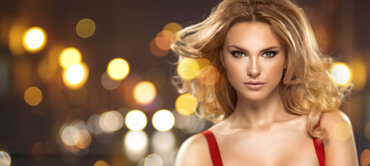 Glamorous blonde beauty on fantasy background