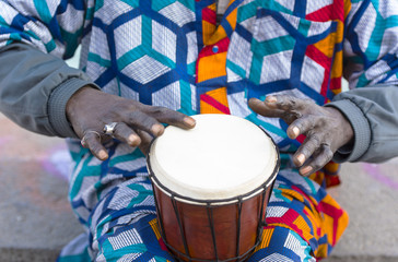 An African drummer beating the drum