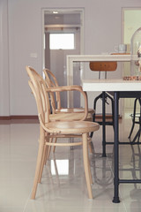 dining room interior with brown table and chairs.