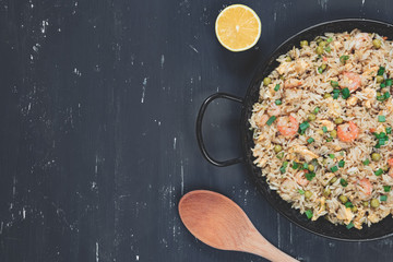 Fried rice with shrimp on the dark background