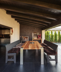 Veranda with table and benches in exterior