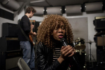 Musicians rehearsing in a recording studio