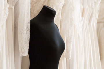 Black female mannequin on wedding dresses background