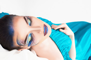 woman with colorful make-up and crystals