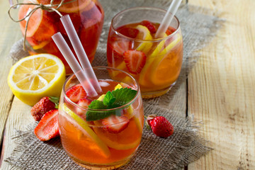 Fruit water. Refreshing summer drink with strawberries, lemon and mint. The concept of healthy and dietary nutrition.