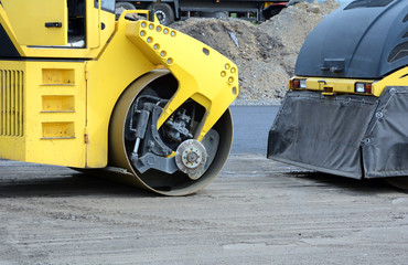Closeup View on the road roller working on the new road construction site. Road repair