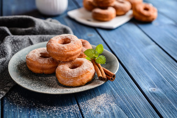 Traditional American doughnuts with cinnamon and sugar icing