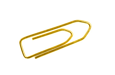 Golden grounge  paper clip isolated on white background close up