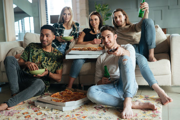 Image of five friends watching TV