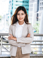 Portrait of a business woman in a suit standing outdoors. Business and lifestyle concept.