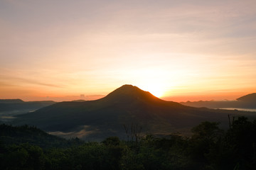 Summer view of soft orange sunset lights in Batur volcano, Kintamani, Bali island of Indonesia. Fantastic outdoor landscape at evening in Southeast Asia, travel adventure photography