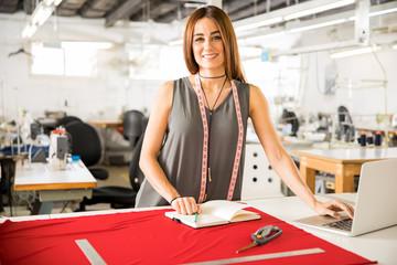 Beautiful fashion designer at work