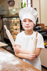 Portrait of a little chef cooking boy