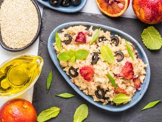 Vegan salad with quinoa, red orange and black olives