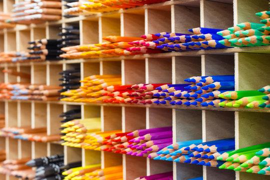Multicolored pencils in art store closeup