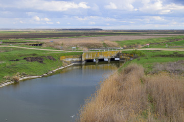 Bridges through irrigation canals. Rice field irrigation system