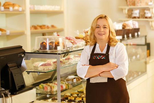 Beautiful senior woman working at her bakery
