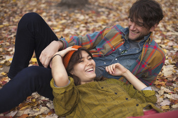 Happy young couple relaxing at park